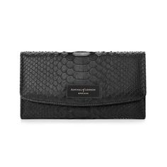 Merging elegant vintage styling with practicality, our Brook Street Purse is handmade from the finest exotic and tactile black python leather and luxuriously finished with our signature grosgrain lining with every hidden pocket lined in moire...