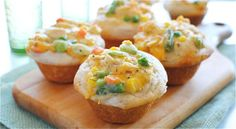 Chicken Pot Pie Cupcakes  1 chicken breast, poached and diced; 1 can cream of chicken soup; 1 cup Green Giant Valley Fresh Steamers frozen mixed veggies; 1 cup shredded cheddar cheese; 1 Tbs Herbs De Provence; 1 tsp onion powder; 1 tsp garlic salt; 2-10oz cans Pillsbury biscuits.   Preheat your oven to 400. In a large bowl, combine the cooked chicken, cream of chicken soup, frozen veggies, cheese, herbs and spices. Lightly grease a 12-cup muffin tin and place the Pillsbury biscuits into each…