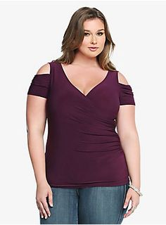 Heat up the night in this sexy, low-cut style. A cut-out shoulder design lets you show off a little skin while a surplice neckline creates a revealing look. A ruched side seam gives this fitted purple top a flattering drape finish.