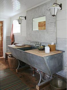 Used to have a sink like this in the basement of our old house growing up... I always thought it was a  scary trough looking like thing but this is really nice with the wooden counter tops!