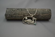 Sterling silver loon pendant with cubic zirconia and turquoise by Joseph Reijnen