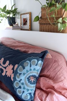 Boho Shared Master Bedroom x Nursery, justina blakeney giola pillow, coral duvet, coral and navy bedding, coral and navy bedroom