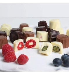 Exquisite treats of the freshest, juiciest blueberries and raspberries that are completely drenched in shells of pure imported white, milk, and dark Belgian chocolates. Quantity: 24 pieces