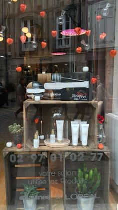/ love in a cage Salon Window Display, Window Display Retail, Window Shelves, Nail Salon Decor, Hair Salon Interior, Store Front Windows, Decoration Vitrine, Window Graphics, Wreath Hanger