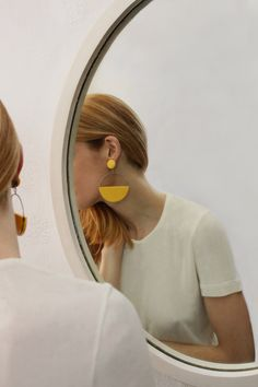 Bonsergent Studio 70's demi lune earrings.