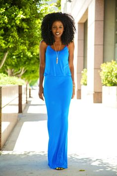 Bright maxi, big hair and minimal jewelry.