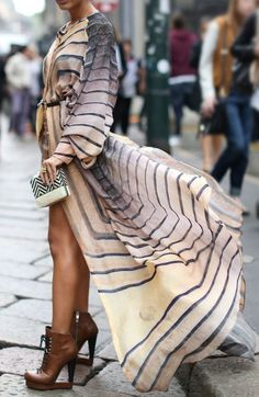 breezy beauty.  Fk yah, the dress is gorgeous... & look @ those boots!!