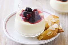 Panna cotta is a classic crowd-pleaser - this one features white chocolate and a sweet berry compote.