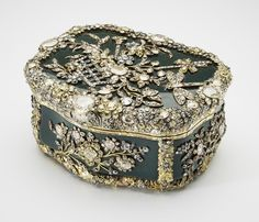A table snuff box owned by Frederick the Great of Prussia, incorporating nearly 3,000 diamonds, which was purchased by Queen Mary in 1932.