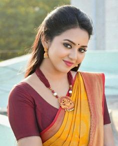 In a yellow color saree, maroon color elbow length sleeve blouse design and necklace Beautiful Girl Indian, Beautiful Girl Image, Most Beautiful Indian Actress, Most Beautiful Faces, Beauty Full Girl, Cute Beauty, Beauty Women, Indian Natural Beauty, Indian Beauty Saree