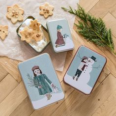 """""""Remember to let the biscuits cool before putting on the lid,"""" says Anna with a smile. Christmas storage tins, price per item from DKK 16,90 / EUR 2,39 / ISK 427 / NOK 23,90 / GBP 2,33 / SEK 23,80 / JPY 268"""