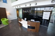 reception desks using wood as a feature - Google Search