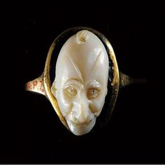 Aboutaams present: Roman Gold Agate Cameo with a frontal head of a grotesque.