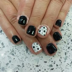 Black and white nails with a fancy nail. Polka dots :)