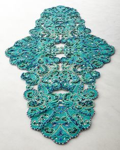 Probably the most beautiful think I have ever seen! This would probably look best on either a very dark colored table, or a beautifully white table. I just love table runners... http://thechicstreetjournal.com/Kim-Seybert-Poseidon-Table-Runner  #KimSeybert #PoseidonTableRunner #MoroccanDecor #TableRunner #TableDecor