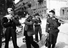 Polish insurgents of the Polish Home Army (Armia Krajowa) are photographed in Warsaw's Tadeusza Czackiego street during the Warsaw Uprising. One partisan (center) carries a captured WWI-era German 7.92 mm Maschinengewehr 08/15 machine gun, whilst his comrade (right) carries a Soviet-made RM-38 50 mm light infantry mortar (August 24, 1944). The Warsaw Uprising was the largest single military effort taken by any European resistance movement during the war. It began on August 1, 1944, as part…
