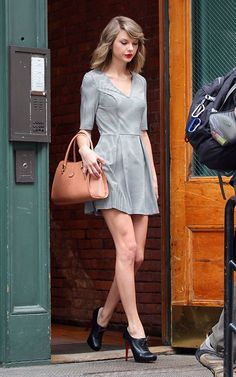 Taylor Swift wearing Christian Louboutin Mamanouck Booties in Black Leather Tod's Sella Tote Guess Plunge Skater Dress