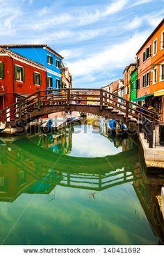 Traditional architecture in the colorful Burano Island, Veneto, Italy. by eZeePics Studio, via ShutterStock