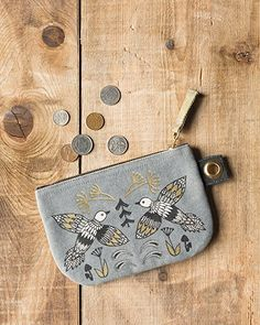 Wild Tale Small Zipper Pouch - A small zipper pouch made from sturdy 100% cotton is perfect for storing small accessories, loose change and more. A metallic zipper keeps contents secure, while a grommet tab adds convenience. Two enchanting birds are arranged in harmonious symmetry amongst dancing foliage, complete with golden metallic highlights. Small Zipper Pouch, Travel Style, Travel Bags, Cosmetic Bag, Contents, Tote Bag, Dancing, Highlights, Metallic