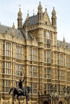 London, UK - The Palace of Westminster and the statue of Richard I