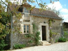 The Barn from the garden and walnut tree; the sunny and secluded patio is round the side Loire Valley, France near Chenonceau