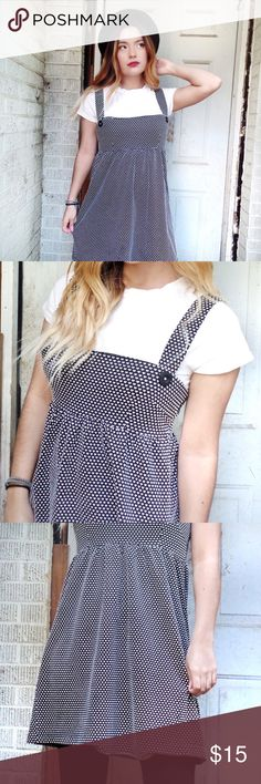 Cute black & white heart dress Easy to style for this fall or winter with tights, you can just add a long-sleeve underneath! If you look closely, it has a heart patter which is super cute! *buttons are fake Dresses Midi