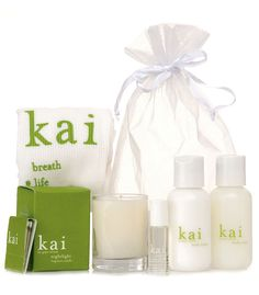 a gift bag with our perfume oil, body lotion, body wash, nightlight candle and kai tank.