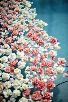 Flowers floating in the pools #TheLANEweddings and #BulgariResortBaliEscape