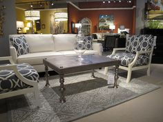 This setting by Century Furniture is gorgeous.  Customize it for your home with a wide variety of fabrics and finishes.