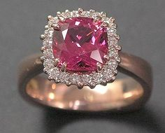 14k red gold with Pink Spinel and Diamond surround