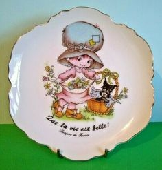 The back has information stating that the plate is for display purposes only. Plate Display, Holly Hobbie, Decorative Plates, Porcelain, France, Ceramics, Type, Tableware, Illustration