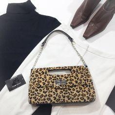 Leopard Clutch/Shoulder Bag Leopard print bag that doubles as a clutch or a shoulder bag. Fashion Bug Bags Shoulder Bags