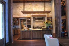 HGTV Dream Home 2005 features a Texas-sized kitchen with creamy limestone and stainless steel appliances.