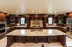 Gorgeous Mediterranean inspired kitchen with gold granite countertops.