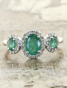 I am obsessed!!! This ring is absolutely perfect!!! Diamonds, perfect green color, and vintage looking! This is exactly what I would want some day!!