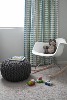 Adorable baby boy's nursery design with Knitted Graphite Pouf, Eames Molded Plastic Rocker in White, gray walls paint color and multi-color dots modern curtains window panels. Boy Nursery Colors, Nursery Design, Nursery Themes, Baby Design, Nursery Ideas, Pouf Design, Nursery Curtains, Nursery Modern, Chic Nursery
