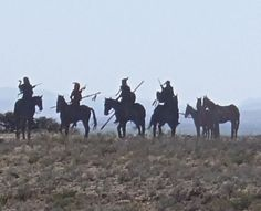 """""""Look to the East"""" a silhouette sculpture representing a small hunting party of Comanche Indians by Brian Norwood located west of Fort Stockton, Texas"""