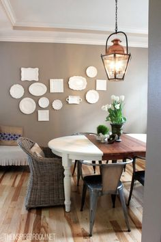 Beautiful white plates on brown wall