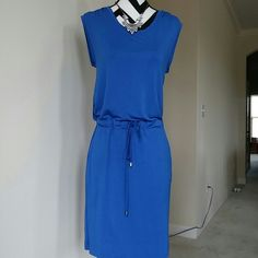 Daven royal blue dress Daven royal blue dress. Capped sleeved. Keyhole in the back with button closure. Drawstring waistbamd so you can wear as cinched or loose as you like. Hidden side pockets. Can be dressed up or down. Lined. Size S. NWT. boutique Dresses