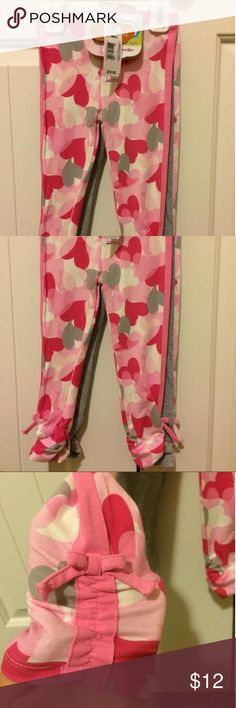 Truly Scrumptious set of 2 leggings Truly Scrumptious set of 2 leggings - one of pink with hearts all over in shades of pink, white & gray. The other is gray with pink hearts along the side leg. Both have slight gathering at the bottom with bows. Size 24M/2T Truly Scrumptious Bottoms Leggings