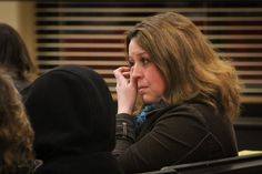 Tina Kibler, a parent with five students at Bedford Schools in Temperance MI wipes away her tears after the school board voted to close Temperance Road Elementary. Recap of the school board meeting at the link.
