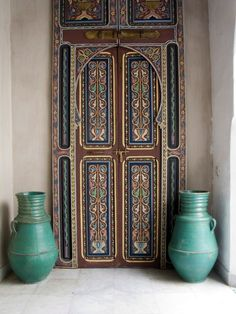 Painted and sculpted doors in a Tangiers riad.