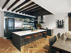 """""""Mirrors are especially useful when there is no, or minimal, natural light in a kitchen,"""" says Wolf. """"They can help to open the space up and bounce light around."""" The designer has been known to use antique mirror tiles instead of traditional tile for a backsplash, or she'll place an antique framed mirror above a stove. """"It's better to look at than a plain wall,"""" she says."""