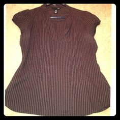H&M Brown Pinstriped Top / Blouse Gently used H&M Brown pinstriped short sleeved top with decorative and flattering pleats. Mandarin style collar. Size 8 or Medium. Smoke Free home. (I also have an identical purple one, too) H&M Tops Blouses