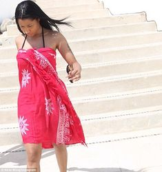 Covered up: Nicki also showed herself wrapped in a cover-up