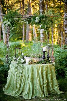 Ana Rosa / Green tablecloth and green foliage makes a very elegant setting for two.