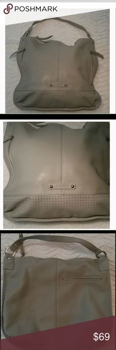 Gray Leather Perforated Hobo B Mcowsky all leather perforated hobo with zip top closure, 1 outside pocket, 3 inside pockets, in excellent used condition B Macowsky Bags