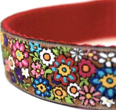 Flower Power Dog Collar. A little floral garden on this ribbon collar. Perfect for your girl pup! It is placed on red heavyweight webbing.