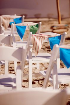 DIY Beach Wedding Inspiration Idea - Dress up white fold-up beach chairs with flag bunting that matches your wedding color scheme #Wedding #Beach #Theme #DIY