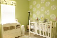 Bright green nursery with stenciled accent wall